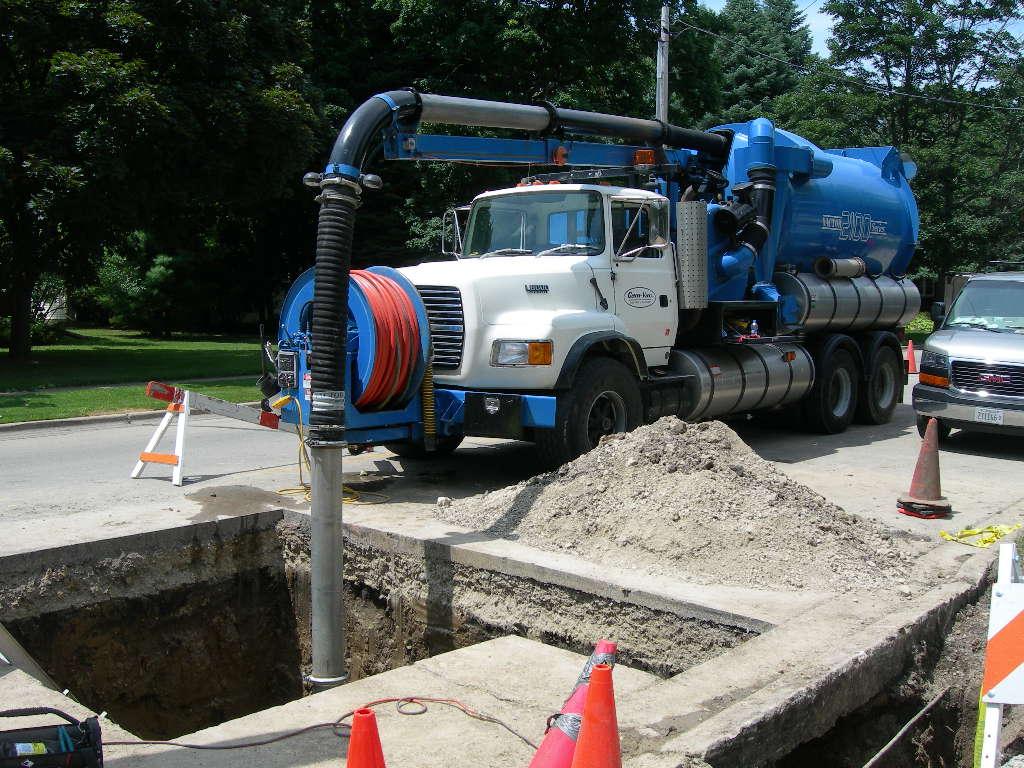 Hydro excavating for sanitary repair
